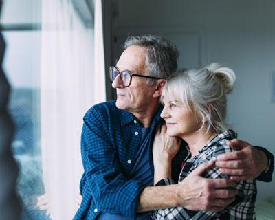 Happy White Senior Couple Standing Near Window - Visa Consultant for Australia and Canada in Pune