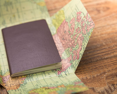 Passport on the world map- Best Visa Consultant Services in India