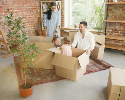 Happy white parents having fun while their kids in cardboard boxes- Visa Consultant in India