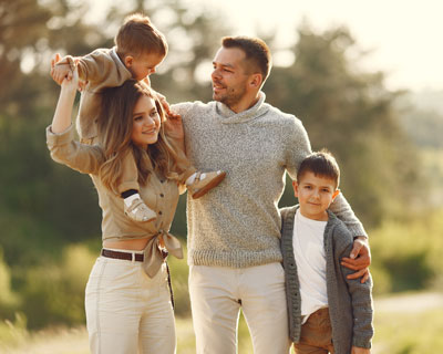 Happy Family Having Fun Outdoors - Immigration Consultant in Pune